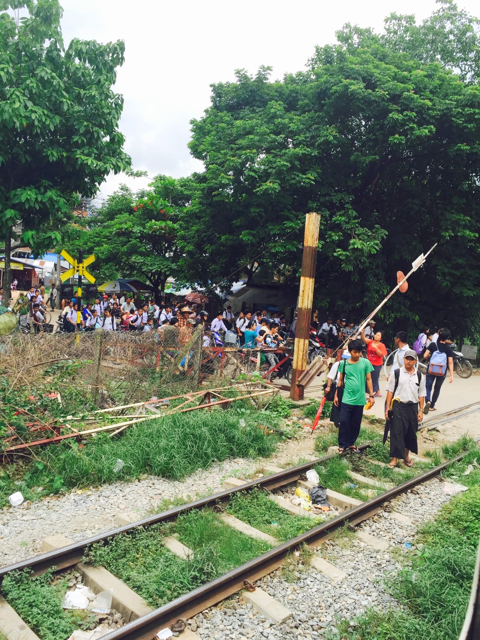 Myanmar kids crossing train tracks