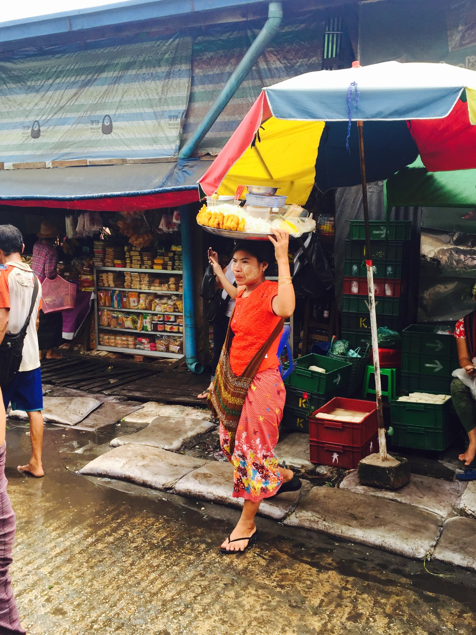 Locals carrying food on head